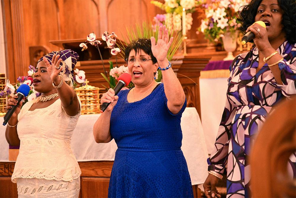 group of black women singing in church