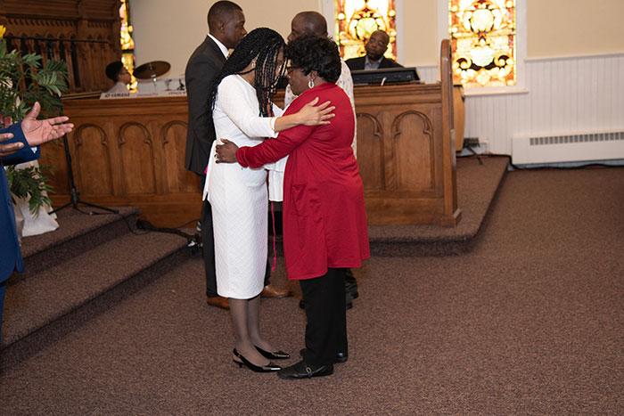 two women hugging inside the church