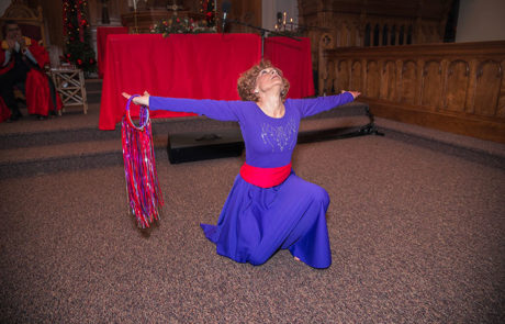 woman in purple and red outfit performing a dance