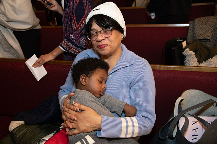 toddler sitting on an adults lap during church