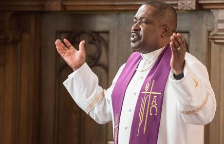 black man speaking during service