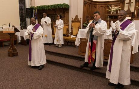 group of church leaders singing
