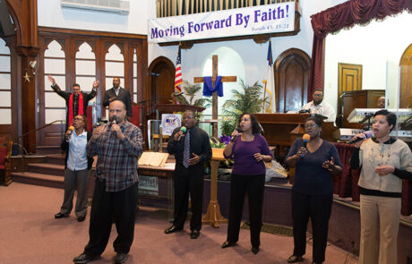group of black people singing during church service