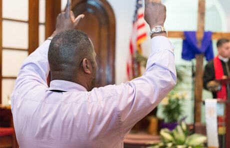 man in church service