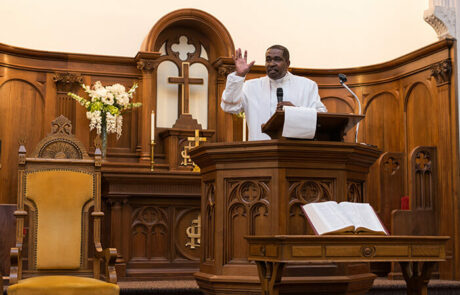 man speaking during sunday services