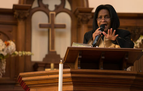 Denyse Edwards speaking to the church