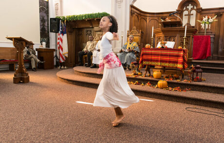 young black girl performing a dance in church service