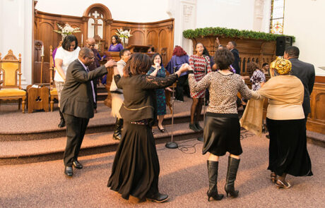 group of churchgoers dancing